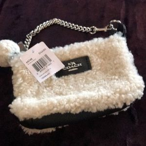 NWT Coach Sherpa black wristlet. Cute Pom attached